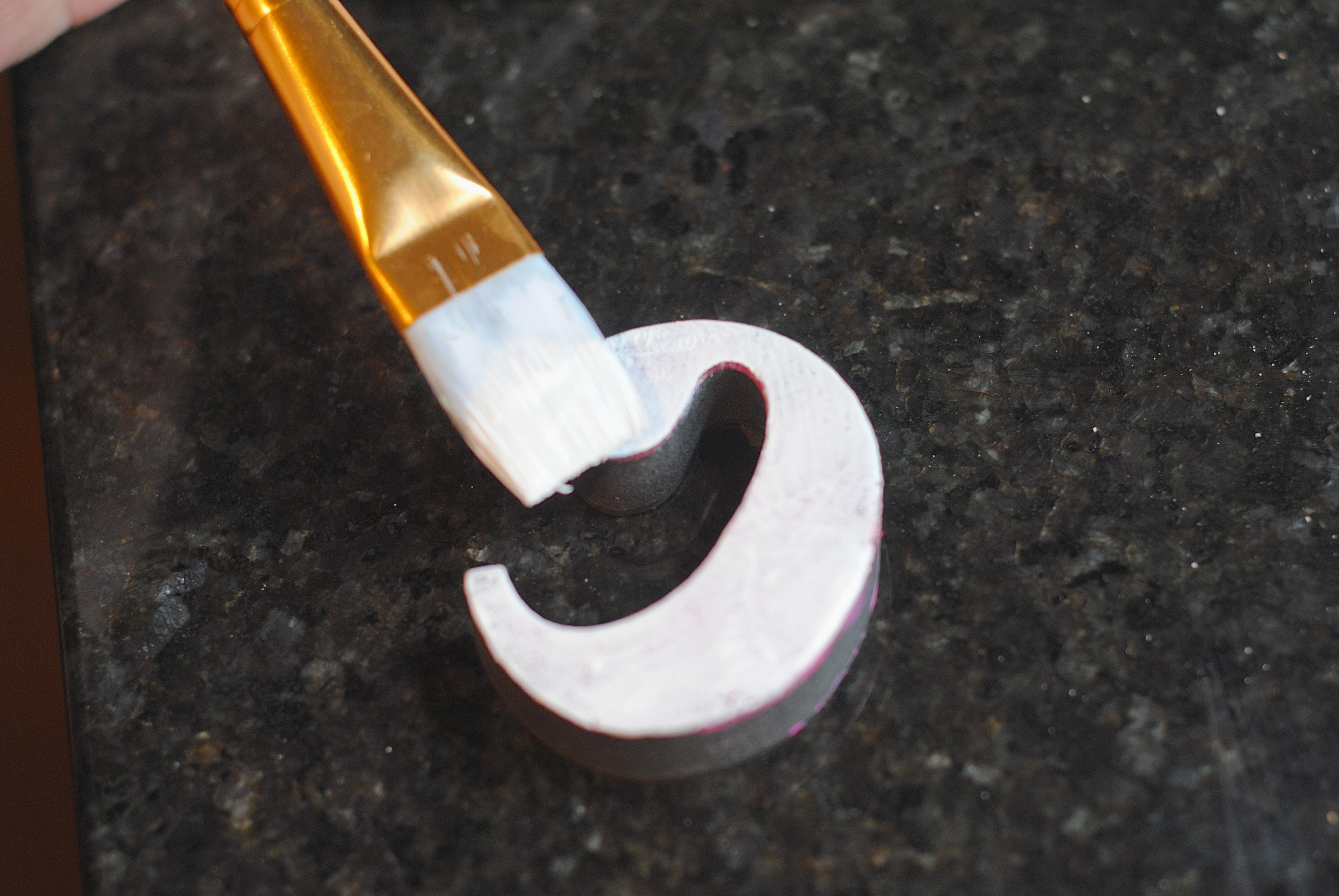 applying paint to a rubber stamp
