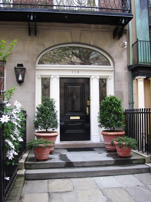 Black front door and porch
