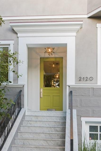 Green front door with star pendants