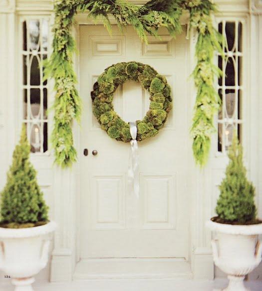 Front door with evergreen decor