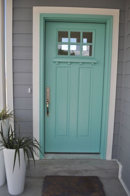 Tiffany blue front door with white trim