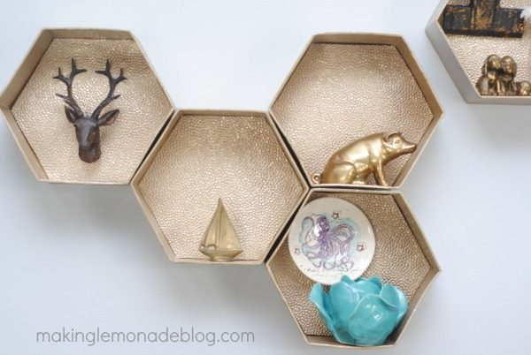 Easy DIY Hexagon Wall Shelves; you'll never guess what they're made from! ! www.makinglemonadeblog.com