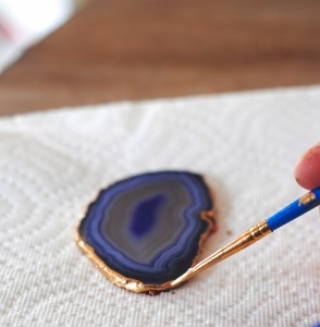 Carefully painting a gold edge on the agate