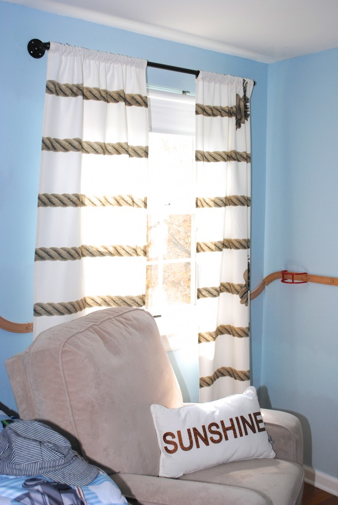 These DIY industrial style pipe curtain rods are a cinch to make, and way cheaper than the West Elm version. Get the tutorial at www.makinglemonadeblog.com! #DIY #knockoff #curtains