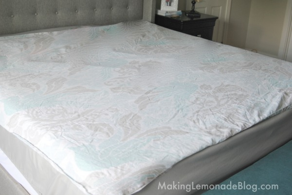 Step 1, lay out the duvet cover inside out on the bed