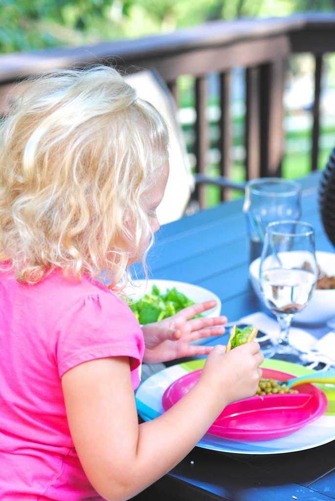 A child eating at a picnic table