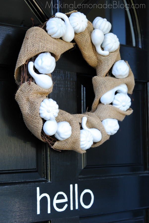 This festive fall burlap wreath was made with Dollar Store pumpkins!