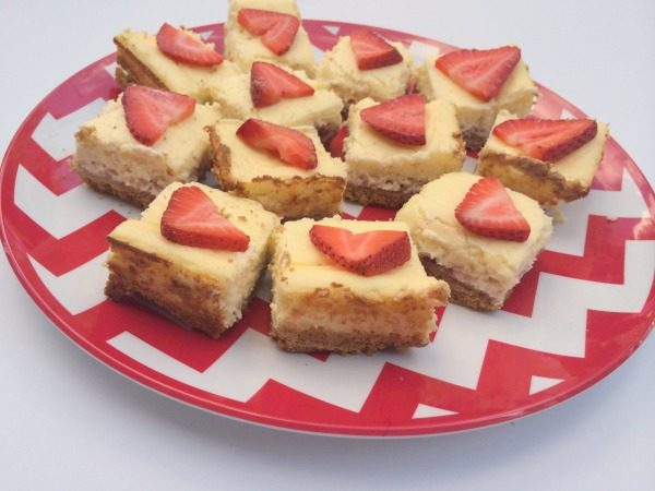 Make these lemon strawberry cheesecake bars in three easy steps! What a perfect summer dessert!