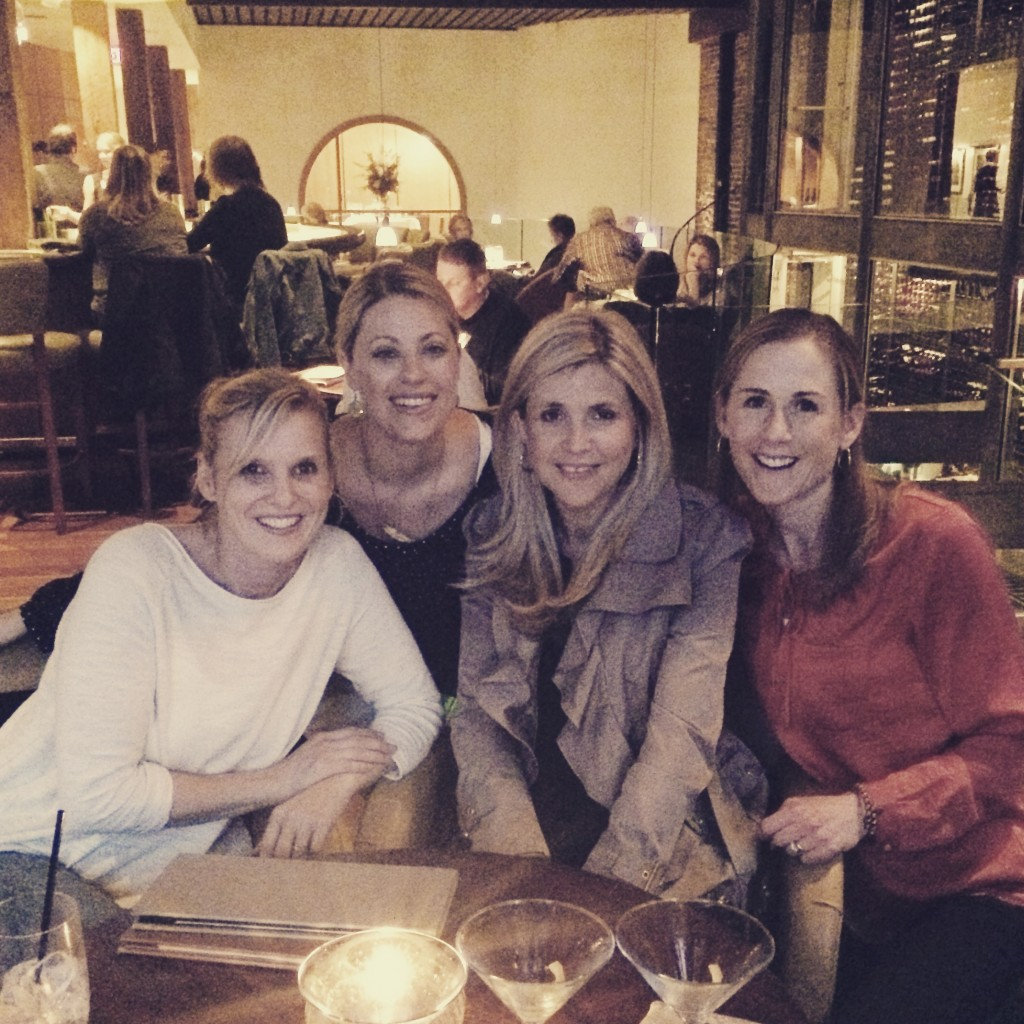 Four friends eating dinner in Charleston