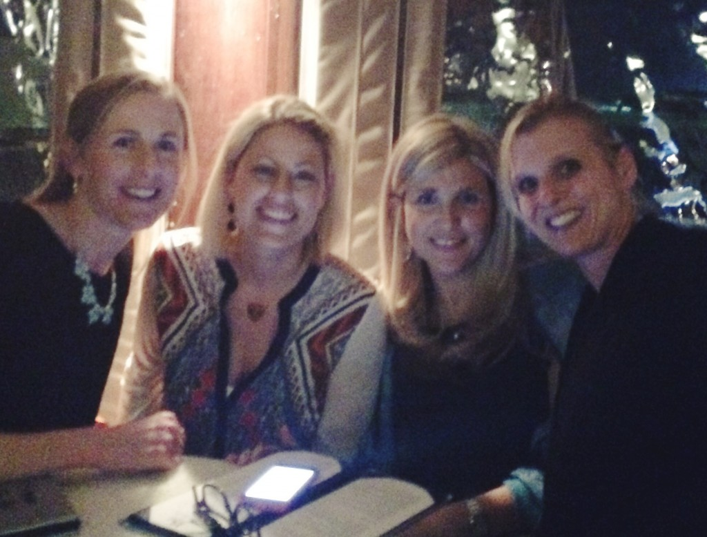 Four friends dining out in Charleston, SC