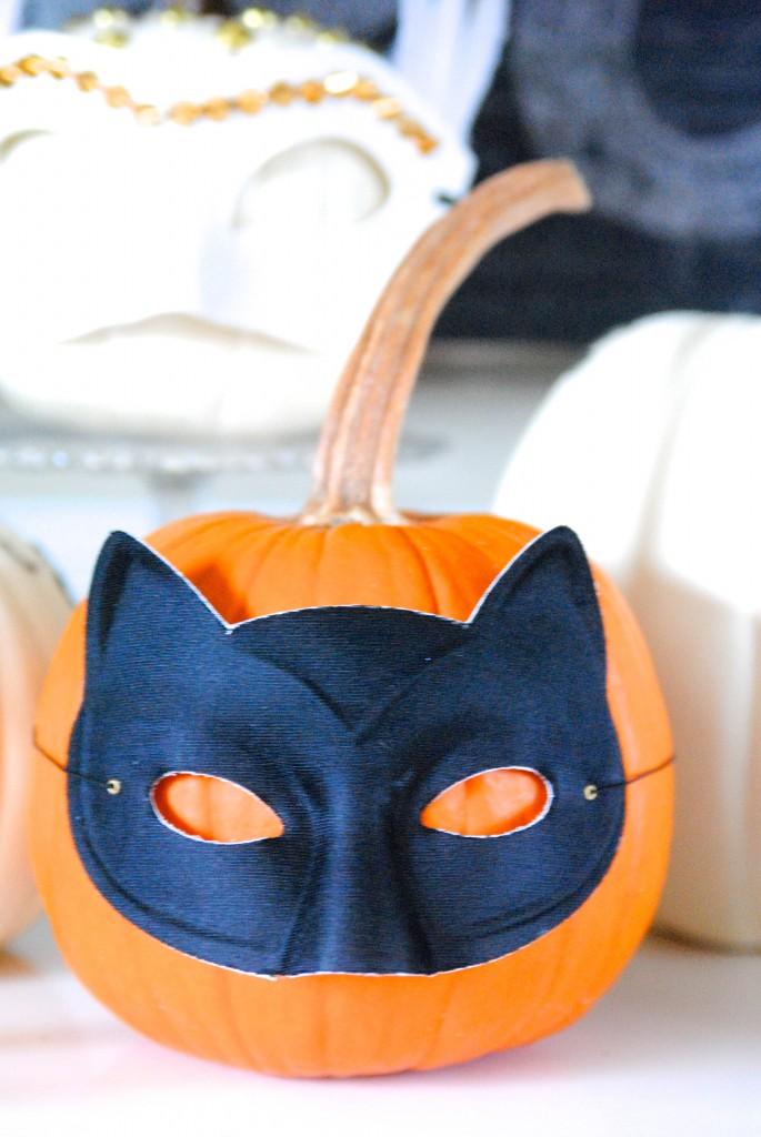 Adorable masked pumpkins