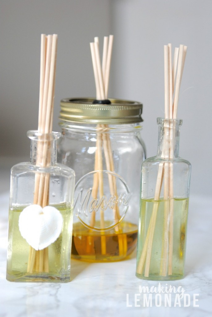 Three DIY Reed Diffusers with essential oils in glass jars
