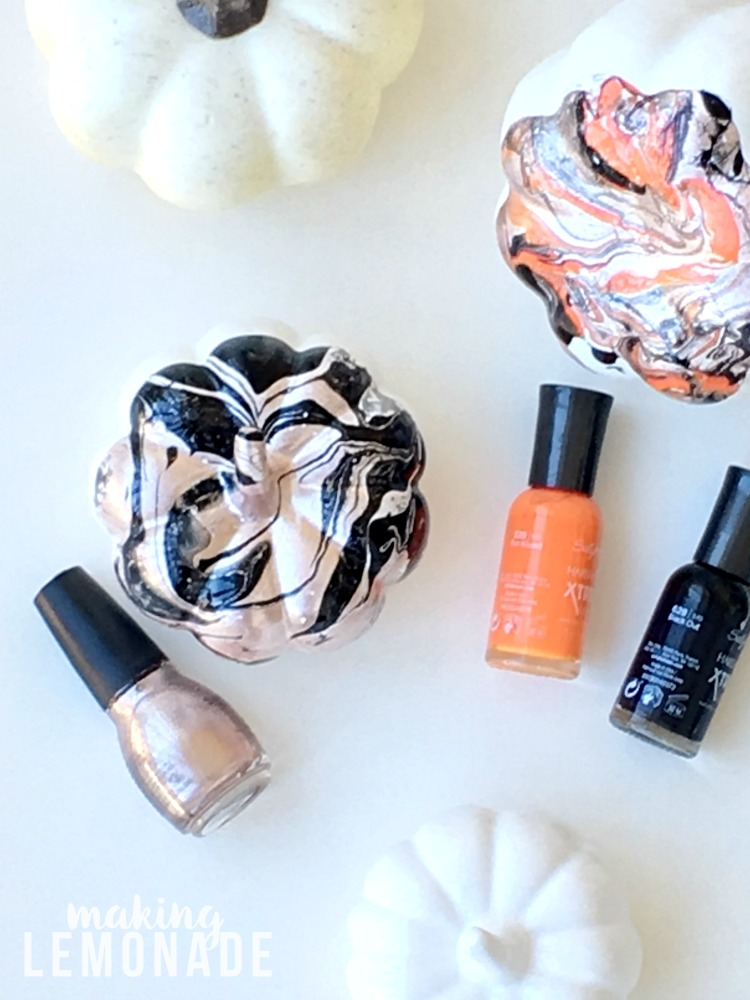 I had no idea you could use nail polish to marbleize ANYTHING, like these marbled pumpkins for glam Halloween and fall decor