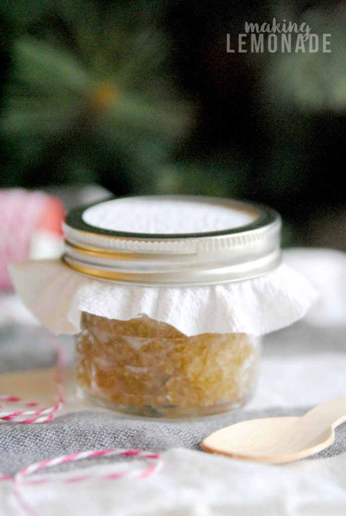 LOVE this handmade holiday DIY gift idea: an essential oil infused hand scrub that's perfect for soothing winter skin!