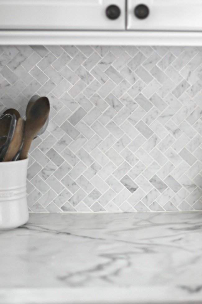 love this herringbone carrera marble backsplash!
