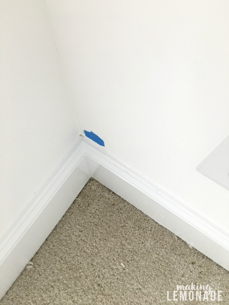 Tag areas that need repair with painter's tape