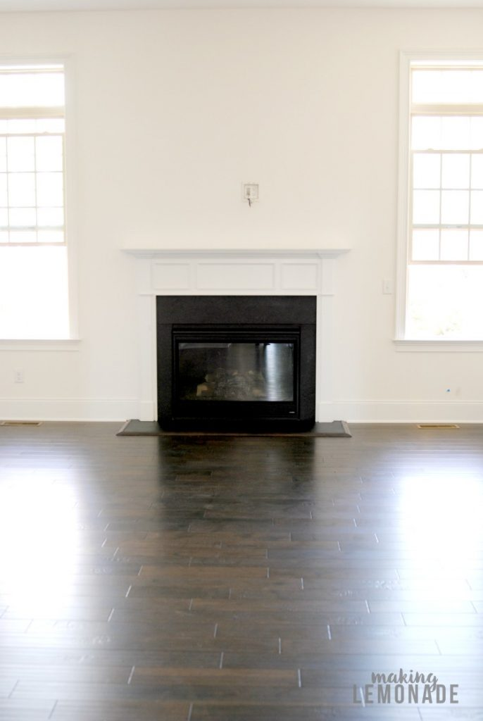 Gorgeous neutral toned new construction home with dark hardwood floors, white walls and marble and quartz countertops!