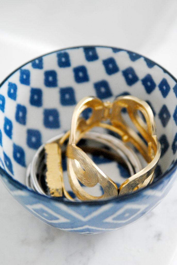 Jewelry in a blue and white bowl