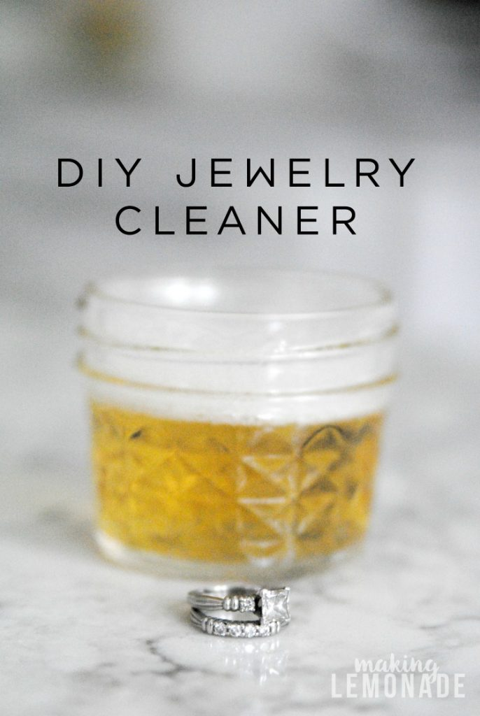 jar with jewelry cleaner and rings