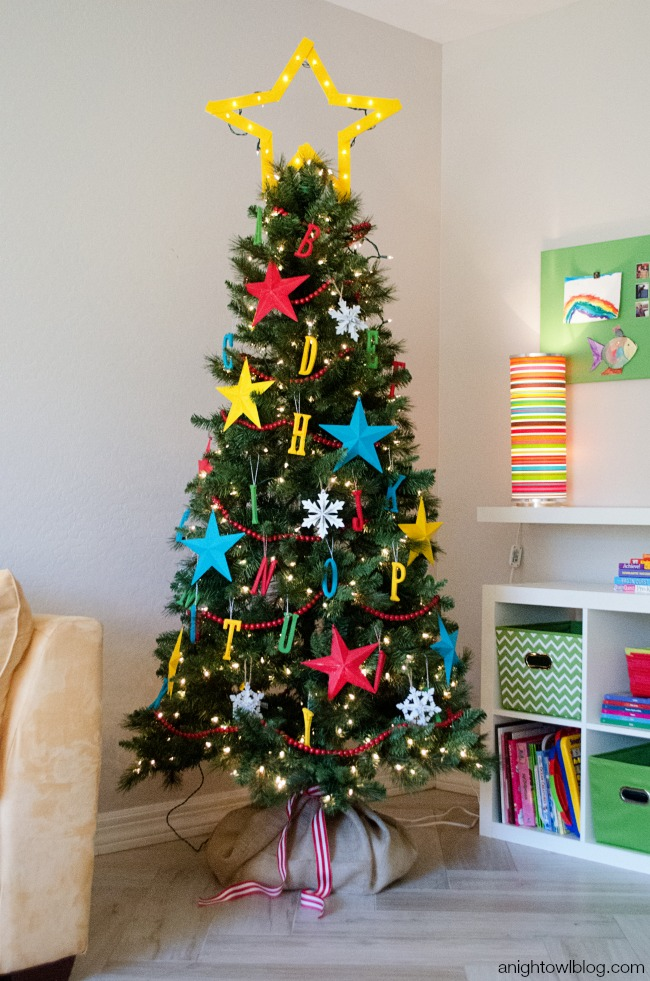 this sunburst mirror tree topper is gorgeous and we love the idea of using a basket instead of a tree skirt it makes artificial trees look so much better - Whimsical Christmas Tree Toppers