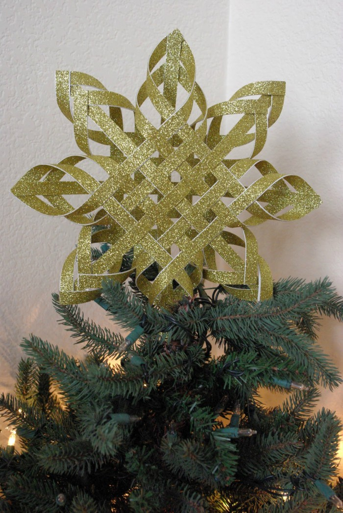 For a semi-DIY option, try this farmhouse snowflake tree topper. Gray and white chalk paint give this wooden snowflake a distressed look that's so charming.