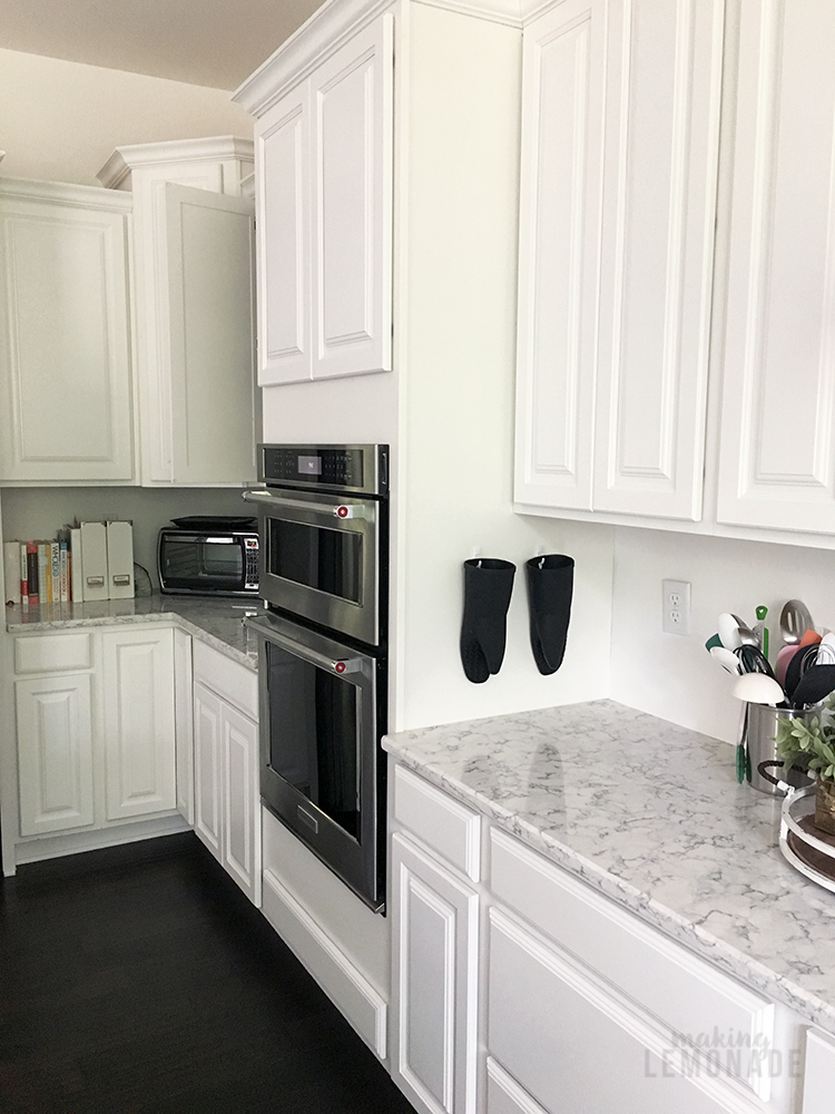 Quick and easy way to update your kitchen cabinets! (lots of decor ideas in this white farmhouse style kitchen, YES to the quartz countertops as an alternative to marble too!)
