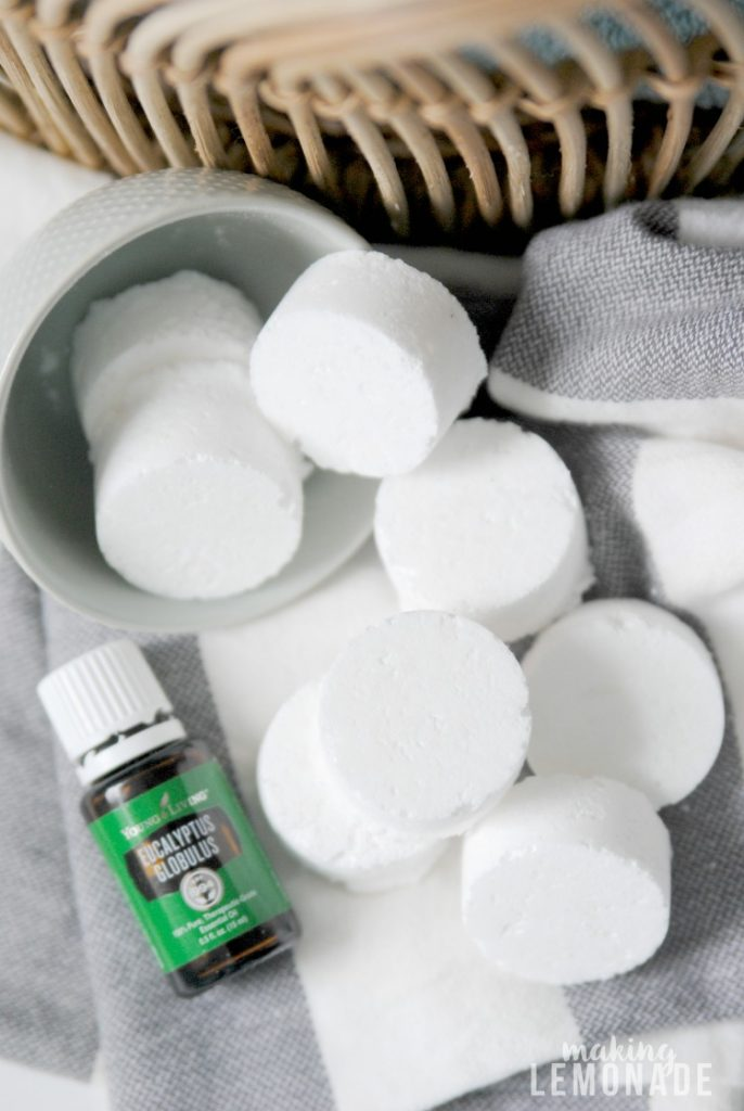 These essential oil infused DIY shower steamer disks are super easy to make and not only support winter wellness and seasonal issues but make your home smell like a spa!