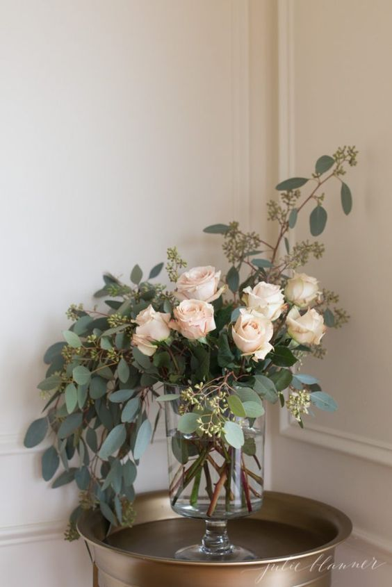 flower arrangement with roses and greenery