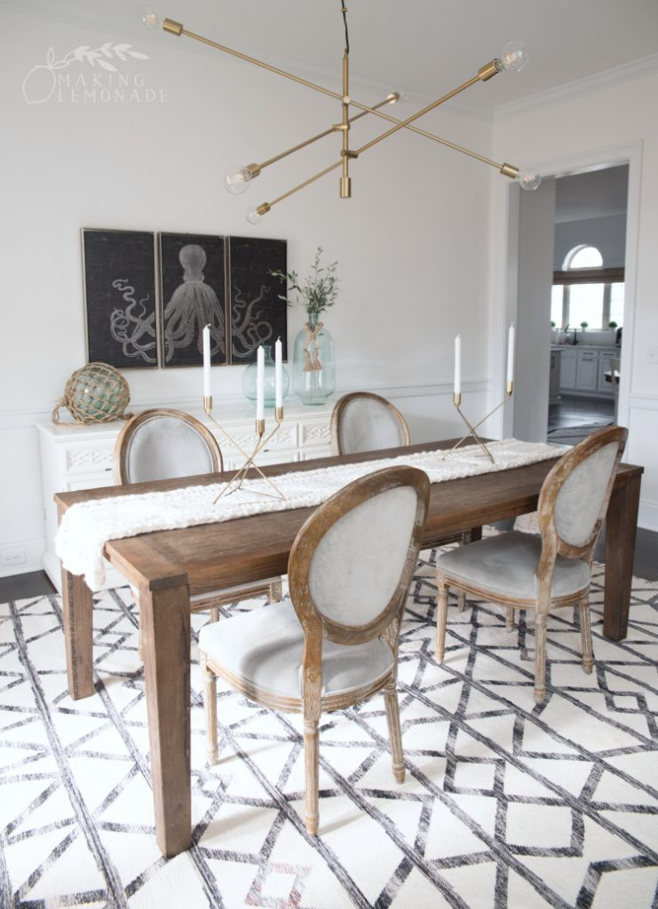 dining room table with gold mobile chandelier