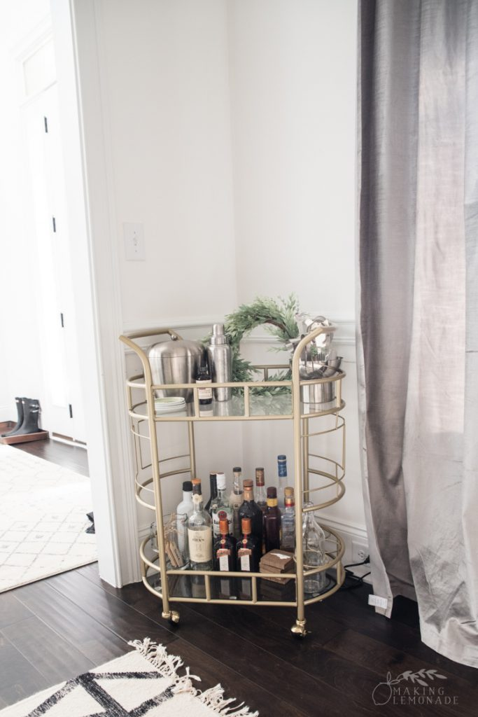 dining room update with gold bar cart