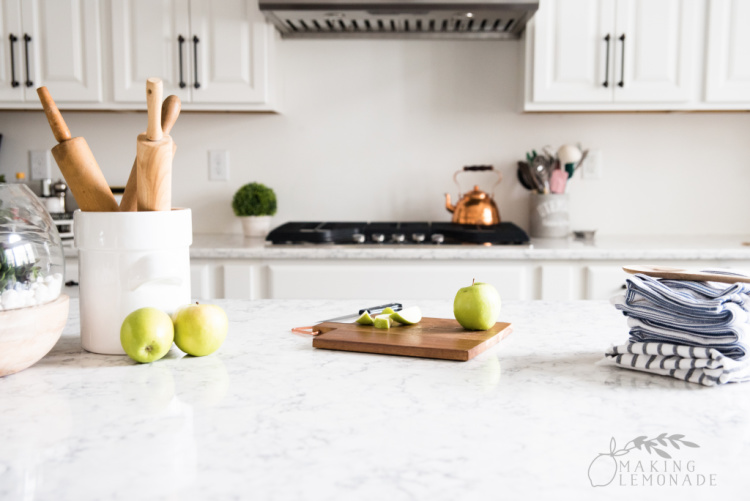 apples on cutting board in farmhouse style kitchen