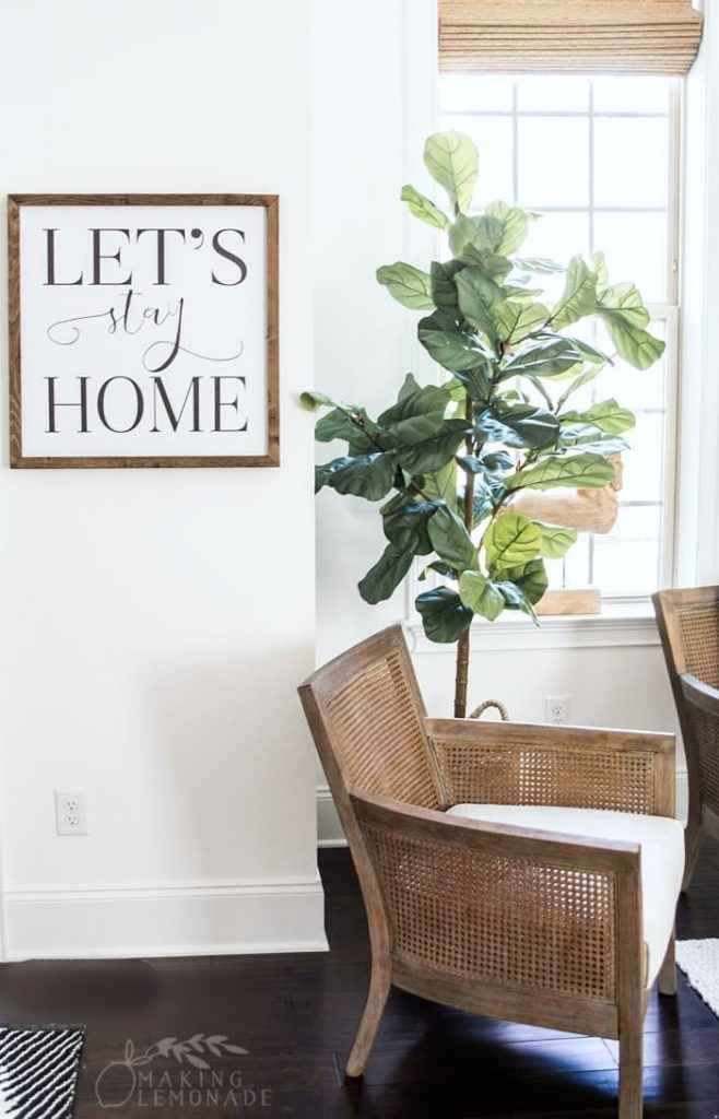 farmhouse style sign with chair and fiddle leaf fit