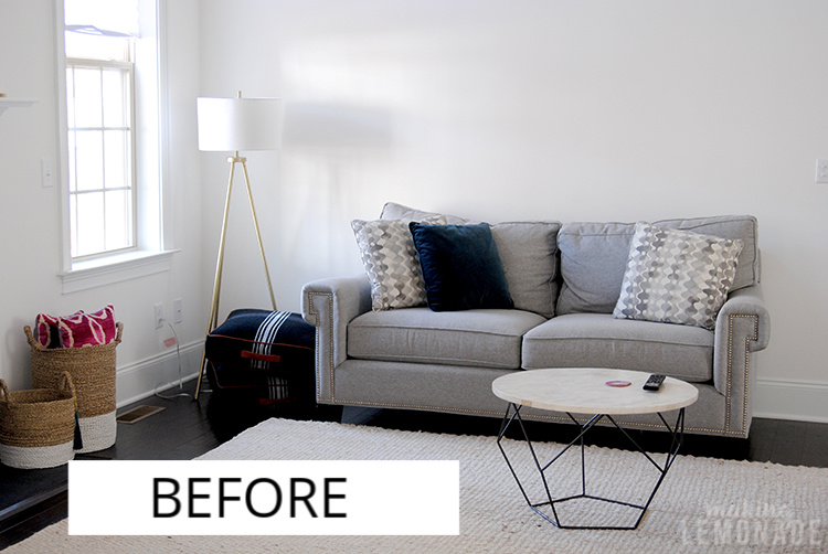 living room with couch and lamp