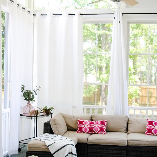 screened porch with outdoor curtains