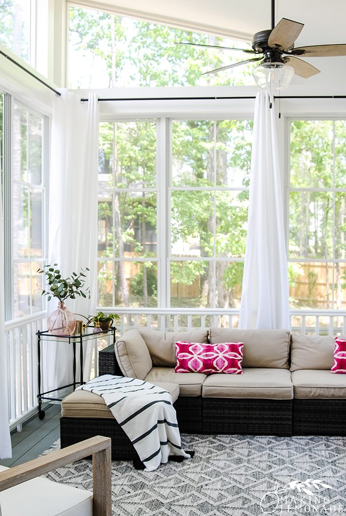 outdoor curtains on a screened porch