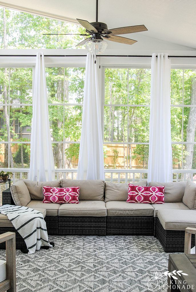 three season porch with outdoor sectional and curtains