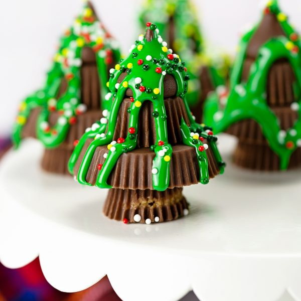 candy christmas trees on white cake stand