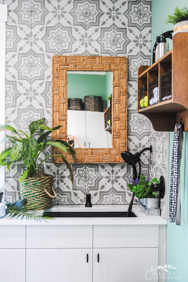mirror and sink in laundry room