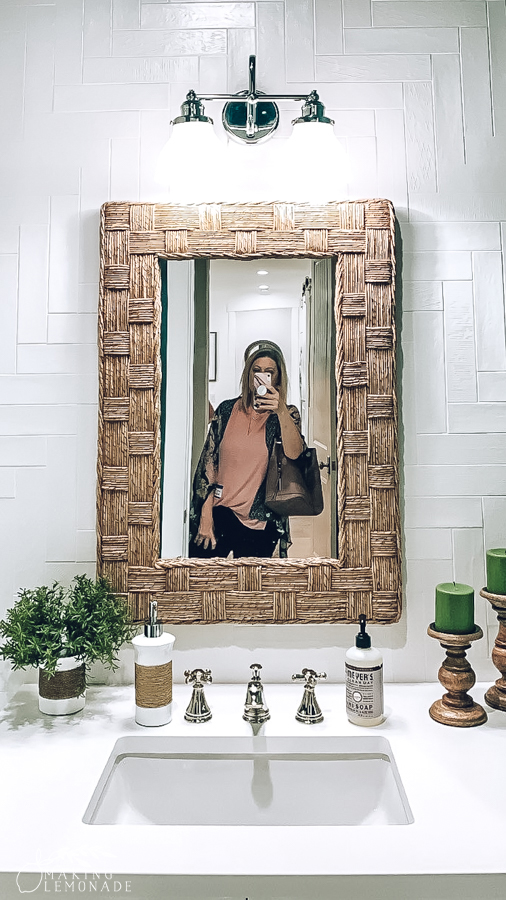 mirror in bathroom with white tile