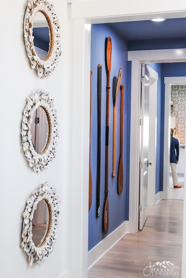 mirrors and oars on wall in hallway