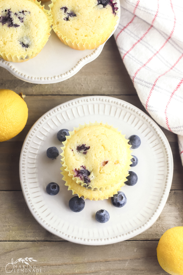 muffins surrounded by blueberries and a lemon