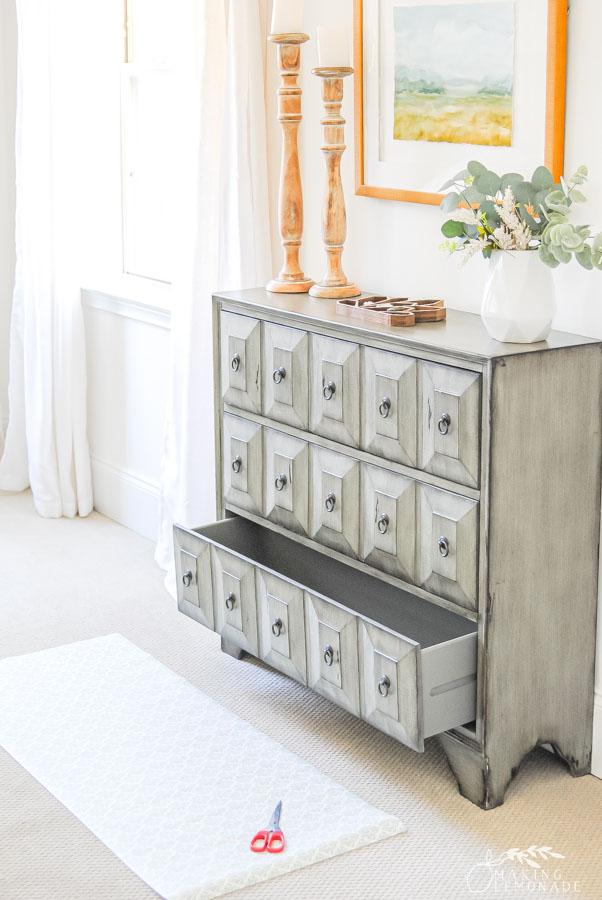 dresser with shelf liner