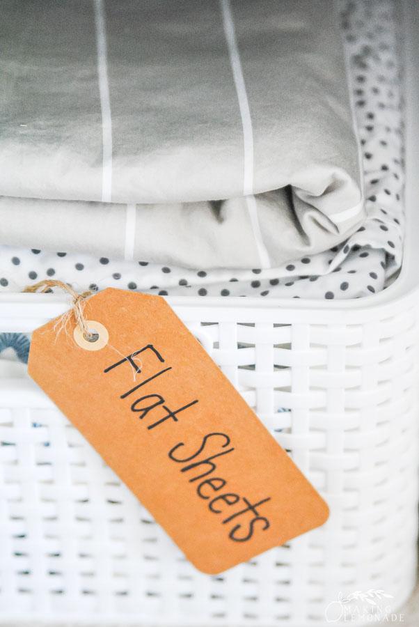 flat sheets in a linen closet