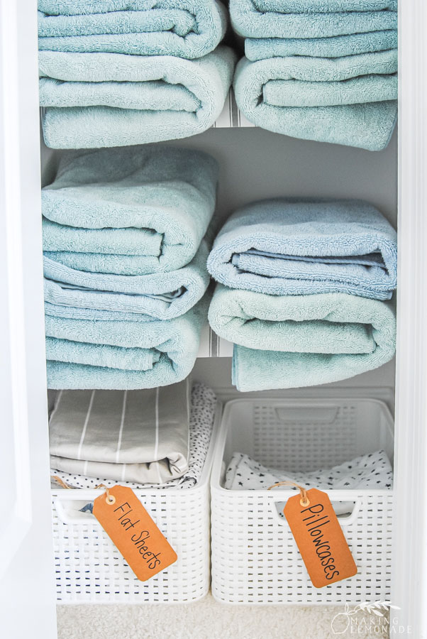 organized towels in a linen closet