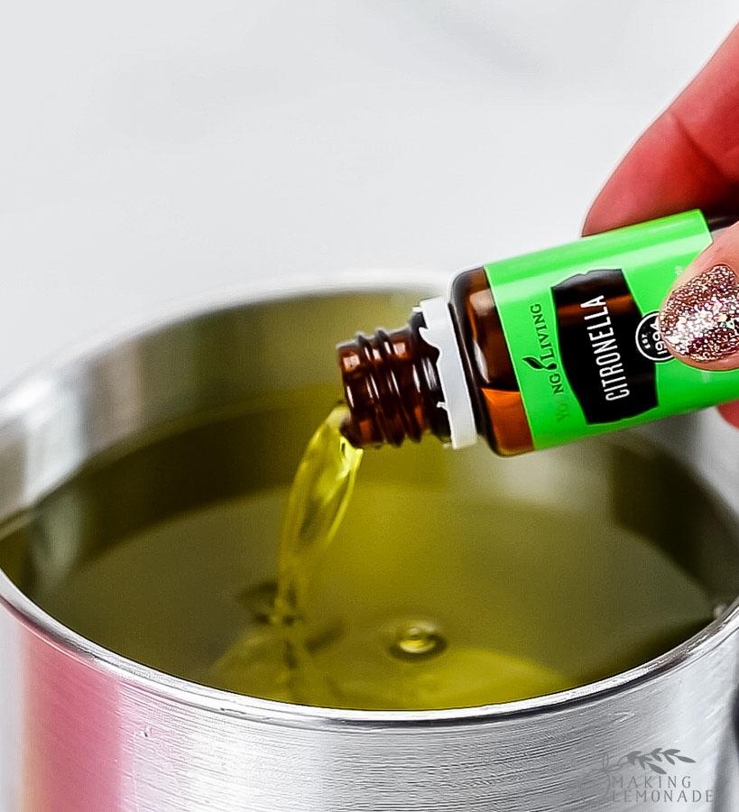 pouring citronella oil