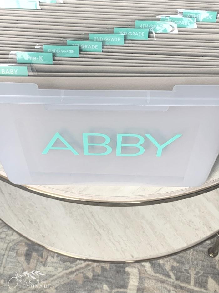 kids' school memory bin with labels