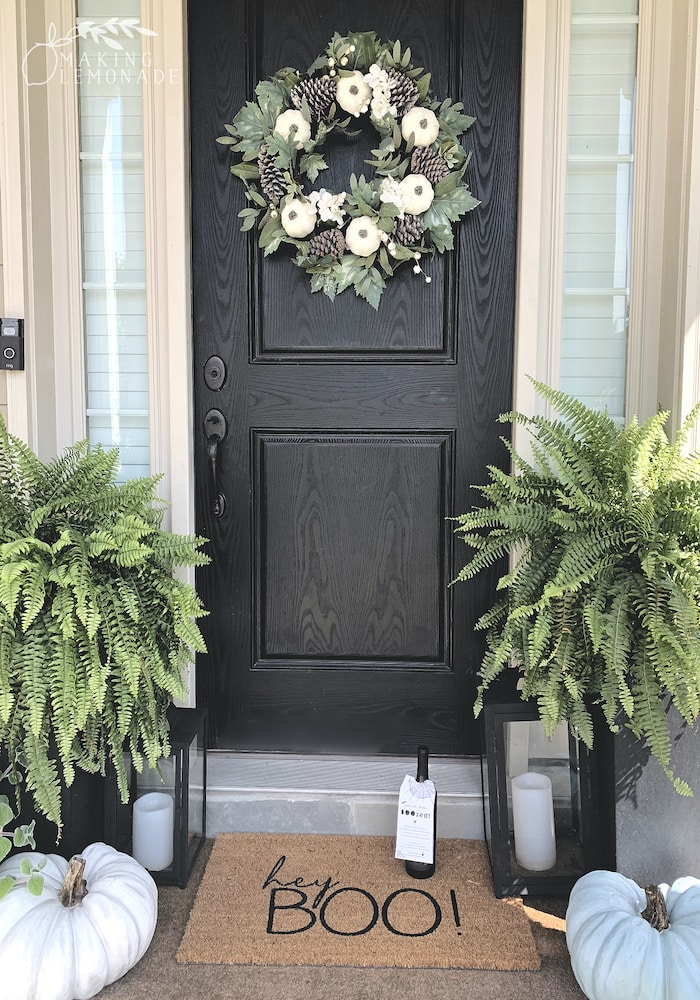 fall front door with wine bottle on doormat