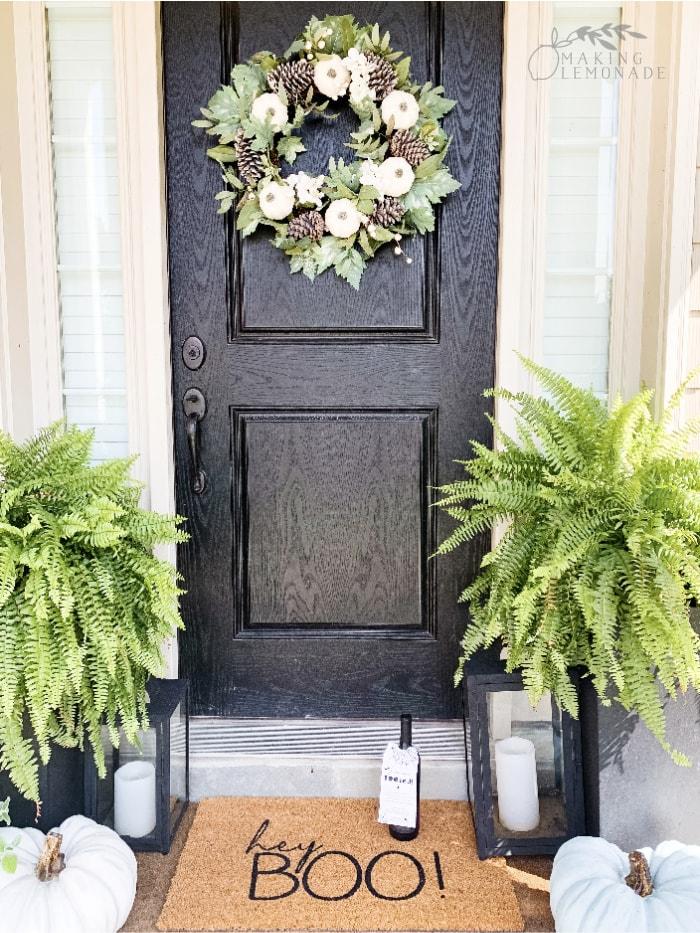 fall doorway with wreath and doormat
