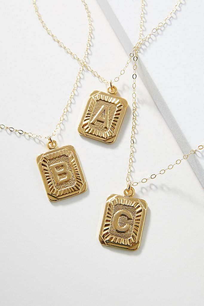 three gold initial necklaces
