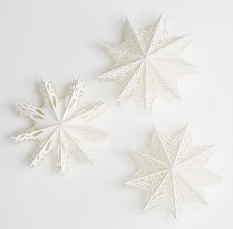 three paper snowflake lanterns